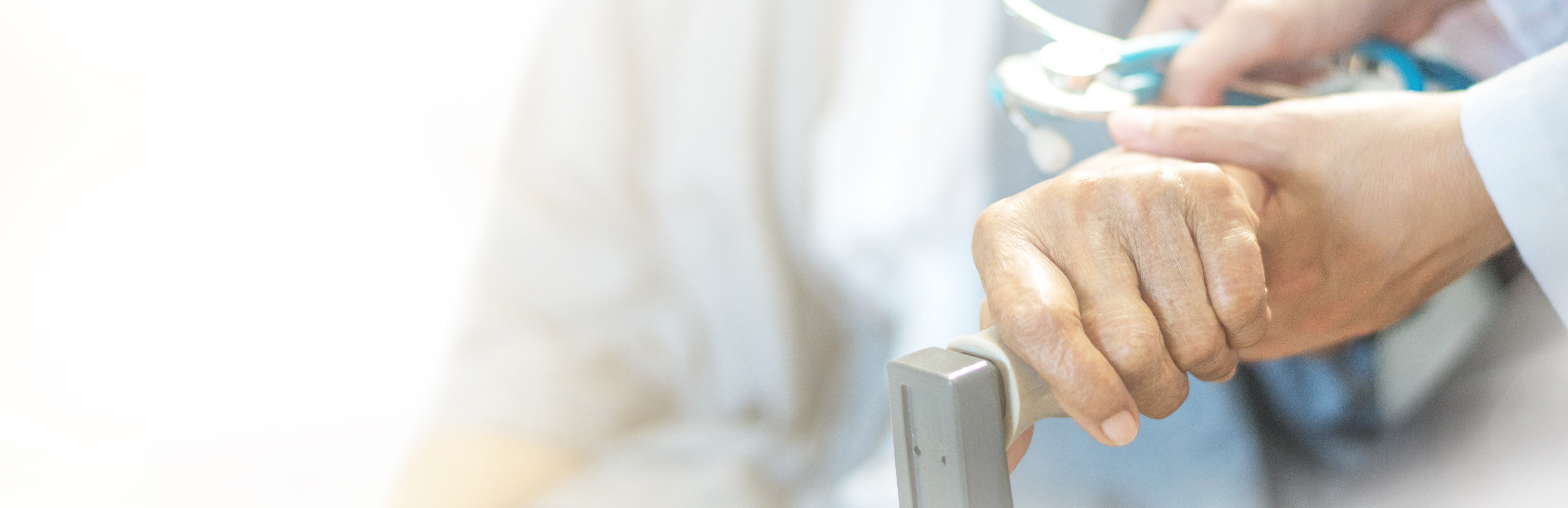 a female doctor is holding the hand of an elderly patient